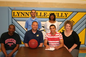 Shown from left are, front row: His father, TC Cunningham of Lynnville; John Henry, William Penn University Head Basketball Coach; TJ Cunningham; his mother, Amy Cunningham of Lynnville; back row: L-S Head Basketball Coach Nick Harthoorn; and TJ's grandmother, Shirley Cunningham of Eastaboga, AL.
