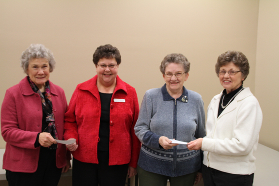 Thanks to the support of the Lynnville Ballpark concession stand operated by the Lynnville Women's Club last summer, $3,200 in donations were recently distributed. Above from left, Sandy Gray, current women's club president, presents $1,400 to Friends of the Lynnville Library represented by Barb Hoogeveen; and Garnet...  </div> <a href=