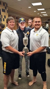 Terlouw and Hulett meet pro golfer Zach Johnson and hold the Claret Jug won by Johnson at the British Open. The Iowa native was an honorary Iowa captain in the Maryland game.
