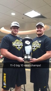 Terlouw and Hulett with the Big Ten West trophy.