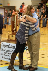 Gena (Fiihr) Schmidt embraces L-S Head Coach Jerry Hulsing, who led the 1995-96 girls basketball team to the state tournament during his fourth season with L-S. Schmidt's experience at state that year was marred by a broken nose in the opening tip-off of the semi-final game.