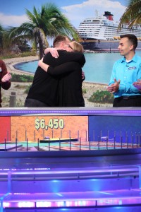 "Jer and Melanie celebrate their success in a ""Wheel of Fortune"" round."