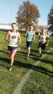 Ty Breeden (middle) proves himself a strong competitor as the Hawks' No. 2 runner at Ankeny.