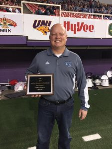 Jeff Corbett is pictured with the plaque given to him at the end of the first quarter of the Class A state football championship game on Nov. 17.