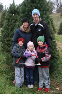 The Arkema family poses by their new tree, which Anna won at Sully Night Out on Nov. 19: Front row, from left, Andrew, Kate, and Evan Arkema; back: Anna and Darin Arkema.