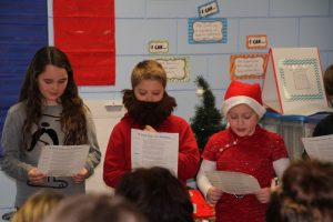"Ashlan Cordes, Ben-jamin Squires, and Emma Stonehocker read their parts in ""A Visit from St. Nicholas."""