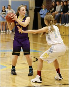 Junior Christine Nikkel guards former L-S student Maria Rasmusson.