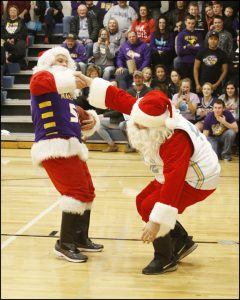 Rasmusson lends a helping hand to Ehresman in their holiday match up.