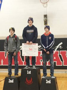Senior Caden Dunsbergen stands at the top of the podium as 138-pound champion at the SICL Conference tournament where he was seeded fourth.